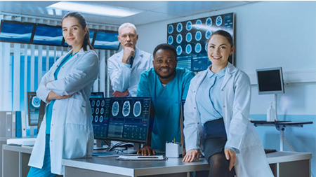 Cross-disease team of scientists collaborating in a lab