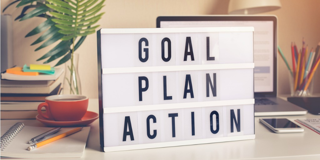 board with words goal plan action